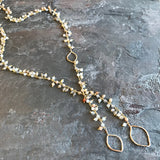 Sandy Lariat by Garden of Silver in gold and opal gemstones.
