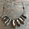 Terra Necklace handmade by Garden of Silver with geodes and sterling silver.