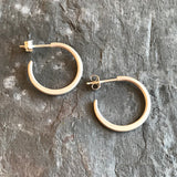 Mini sterling hoop earrings by Colleen Mauer at Garden of Silver in Westhampton Beach, New York.