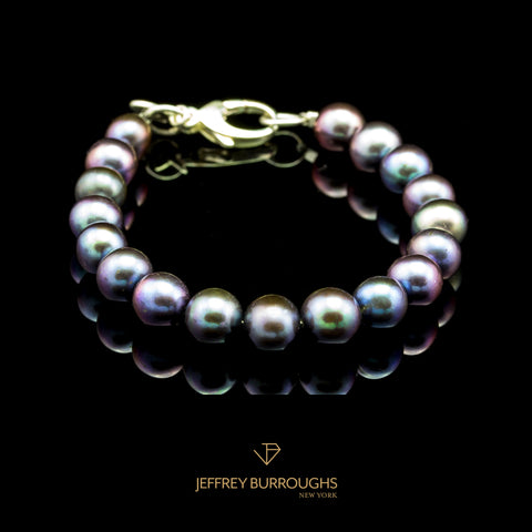 Peacock Pearl Bracelet by Jeffrey Burroughs at Garden of Silver in Westhampton Beach.