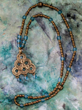 Load image into Gallery viewer, Berber Spiral Brass Etched Pendant with Turquoise Recycled Glass beaded Long Necklace