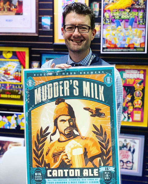 Photo of artist Brian Miller with artwork at SDCC Relieve the heroic Jaynestown episode with this new Firefly artwork featuring Mudder's Milk. This collectable Firefly artwork by illustrator Brian Miller is perfect for your man cave, home bar, or den. Add this officially licensed Firefly artwork to your collection & remember to pour a frosty mug of Mudder's Milk!