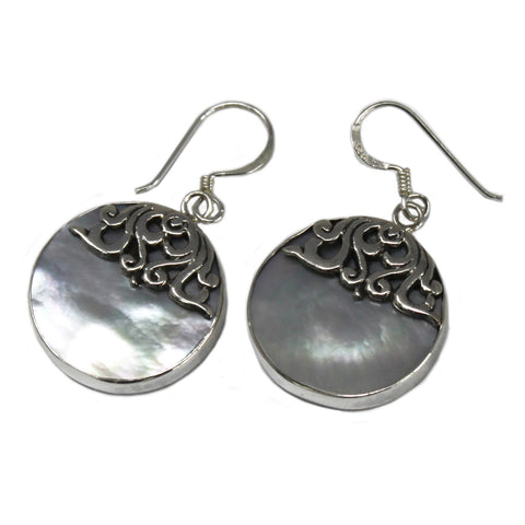 round shell and silver earrings