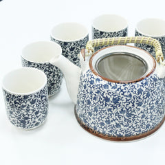 blue herbal teapot with cups