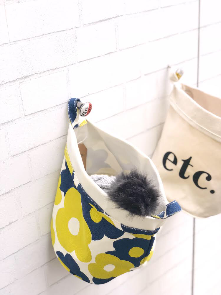 hanging MAIKA canvas buckets in entryway
