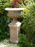 stone plinth and urn