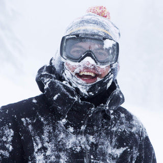 BlackStrap The Expedition Hood Balaclava Snowboarder Wearing Under Beanie in Snow