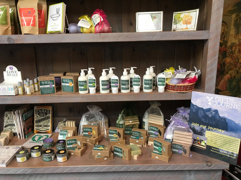 lotions and soaps on a shelf in a gift shop