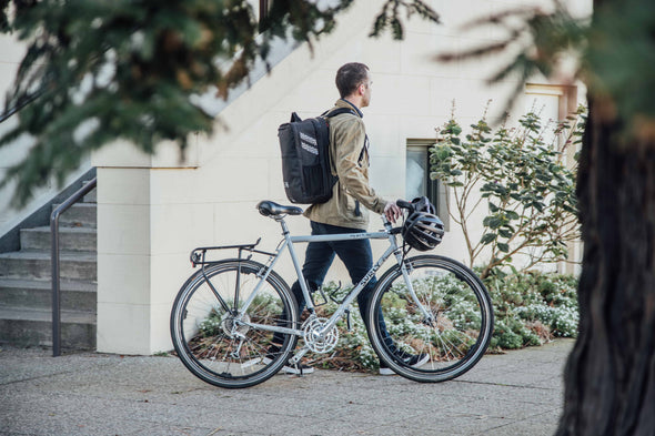 Two Wheel Gear - Pannier Backpack PLUS+ - Bike Commuter - Man with Bike