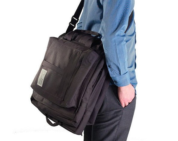Classic 2.0 Garment Pannier being carried on man's shoulder