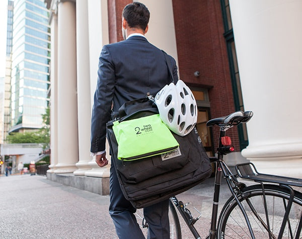 Man in Suit Carrying Two Wheel Gear Garment Pannier with Bike