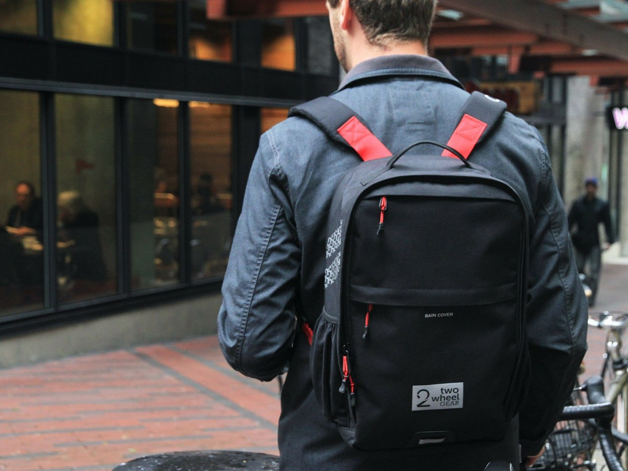 Black Pannier Backpack Convertible on Man with Coffee - Two Wheel Gear