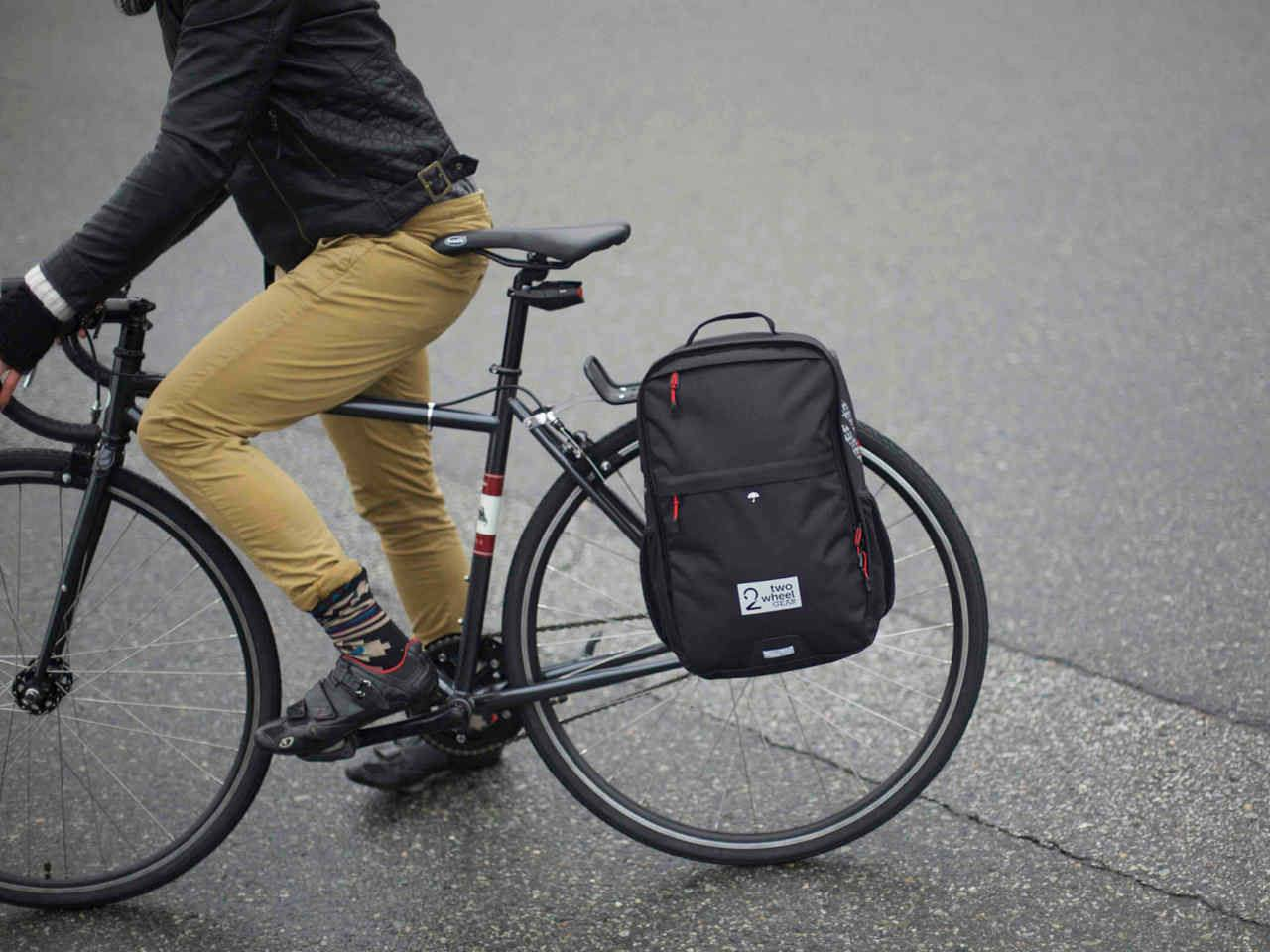 Black Pannier Backpack Convertible on bike with woman - Two Wheel Gear