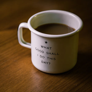 On a table, a coffee mug with the saying
