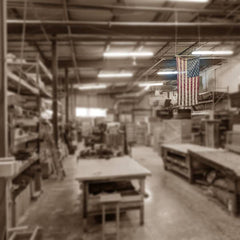 United States Flag hanging in ceiling of factory