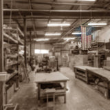 workshop with american flag hanging from the ceiling