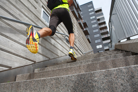 Man with running backpack on stairs