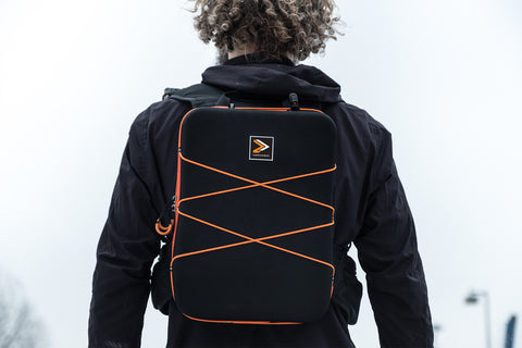 Man with running backpack standing in winter wonderland
