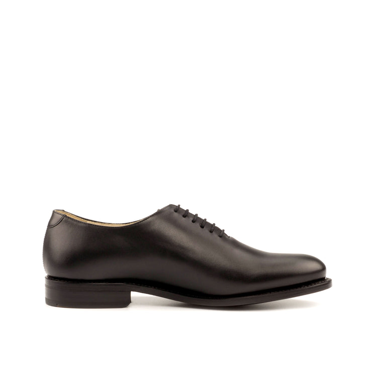 Premium, handmade black whole-cut dress shoe called the Preston