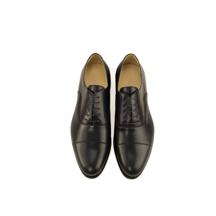 Overhead view of a premium blue leather classic oxford dress shoe