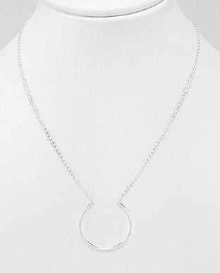 Horse shoe necklace in sterling silver by Kesley
