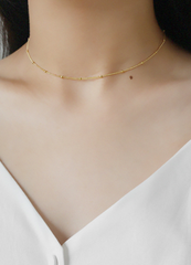 Gold delicate choker by Kesley