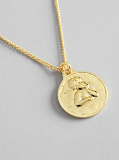 Gold Angel necklace by Kesley