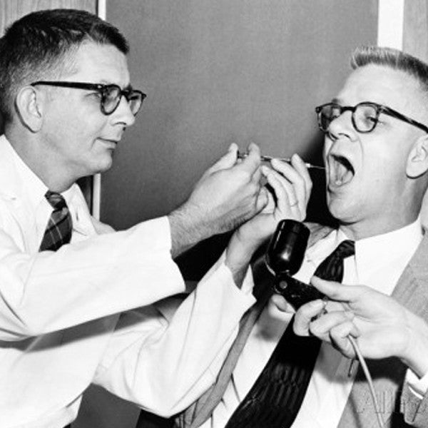 Dr. Harry Williams Squirts LSD into Dr. Carl Pfeiffer's Mouth, 1955