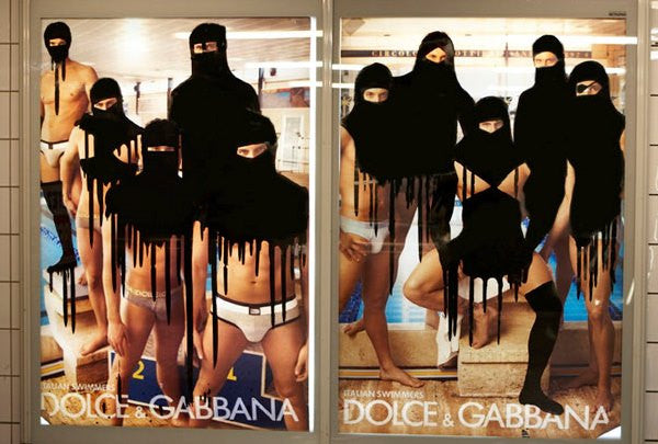 Dolce and Gabanna advert covered in graffiti