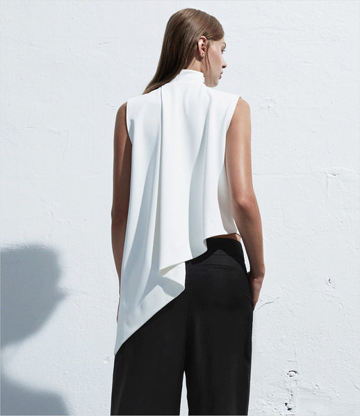 Arethé-Stockholm_white_black_asymmetric_hem_top_high-neck_crop_COS_minimal_85_fashion_womenswear_kidsofdada