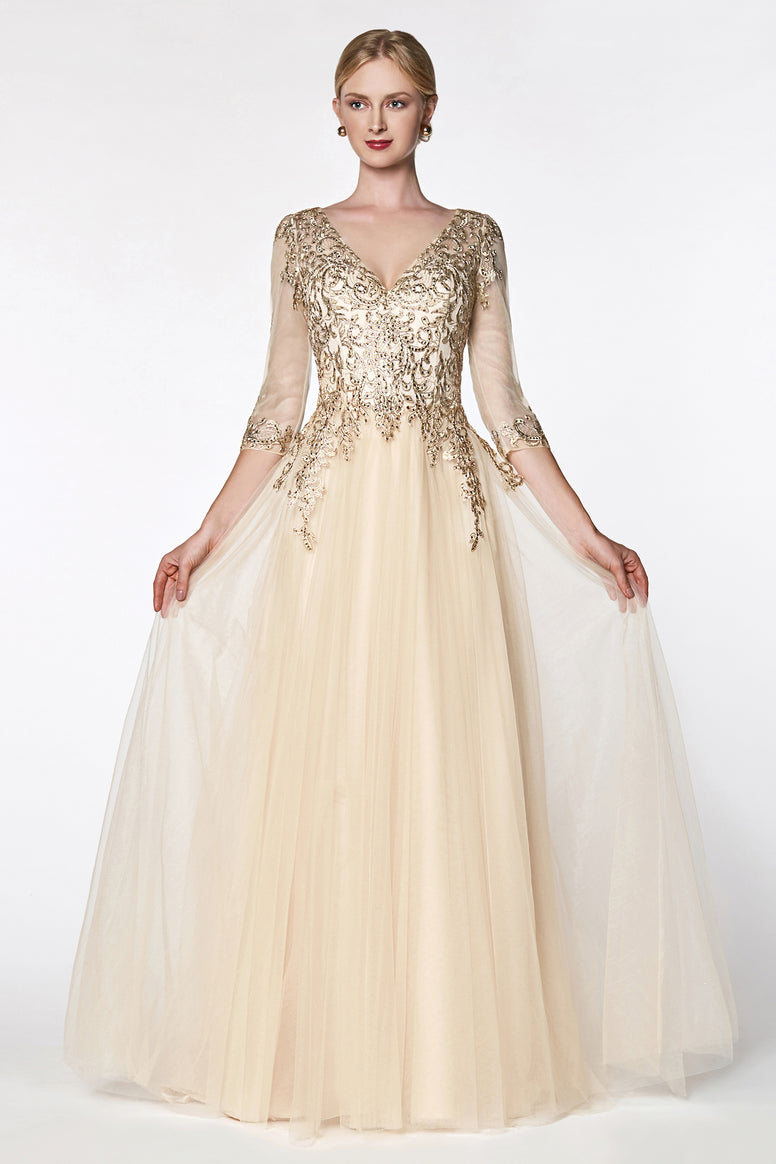 Magical flowy layered A-line tulle gown with three quarter sleeve and lace bodice.