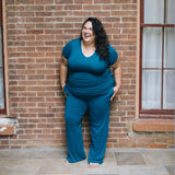 Woman wearing CoolRevolution sleep pants and Tshirt in twilight blue