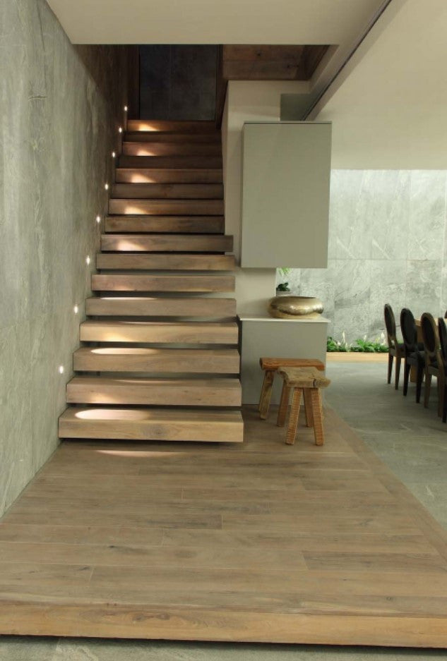 Wood Floors go above and beyond: walls, stairs and ceilings enjoy the natural touch with a wood finish