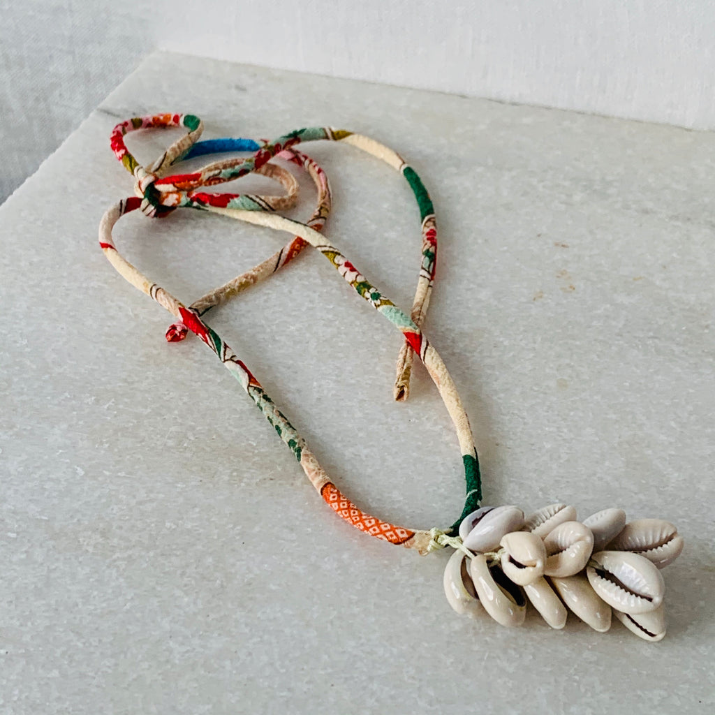 Kirsten Merrill Jewelry Finley Cowrie Tassel on Vintage Kimono Fabric Cord Necklace.