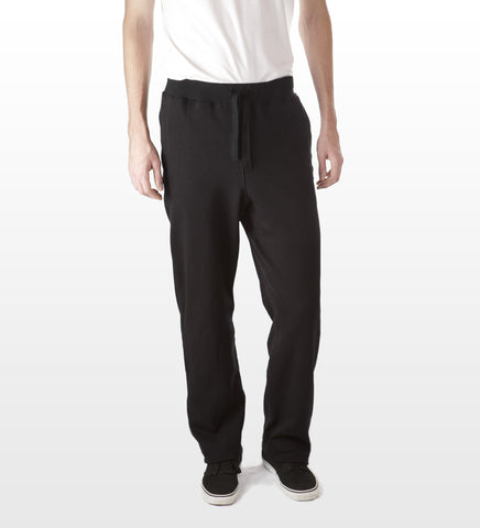 Black cotton fleece sweatpants, model is 6-8 and wearing size XTall-Large.