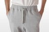 Athletic grey cotton/poly fleece sweatpants front detail view, model is 6-8 and wearing size XTall-Large.