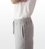 Athletic grey cotton/poly fleece sweatpants side view and pocket detail, model is 6-8 and wearing size XTall-Large.