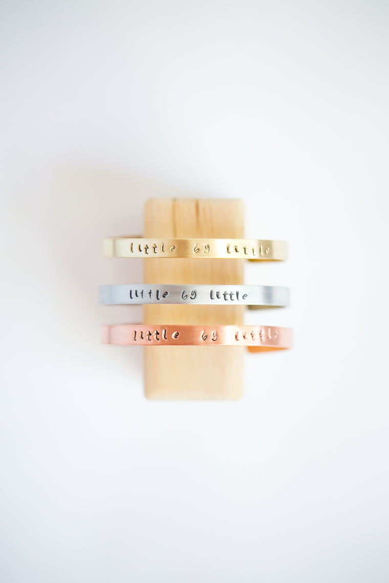 "Brass, aluminum and copper ""Little by Little"" cuff bracelets"