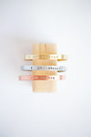 Brass, aluminum and copper I Am Enough cuff bracelets