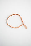 Copper beaded bracelet with rose gold-filled tag