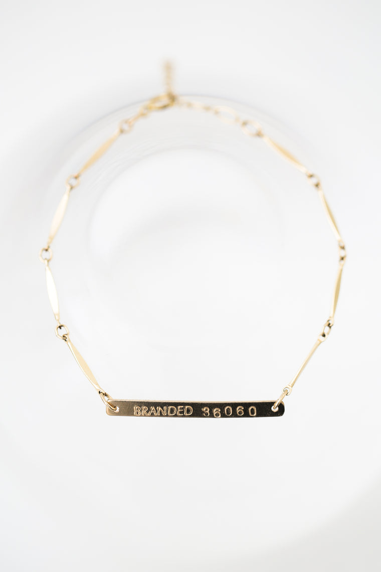 gold filled chain BRANDED bracelet on a white background