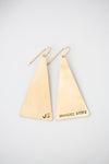 brass triangle earrings on a white background
