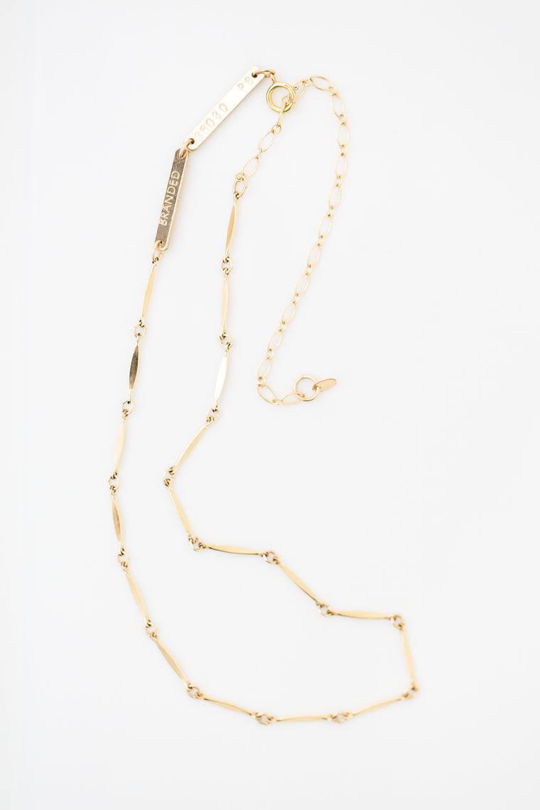 gold-filled chain necklace on a white background