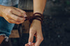 Woman wearing Walk in Freedom Leather Wrap with Knot Clasp