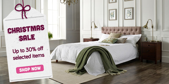 Bed in bedroom with Christmas sale tag
