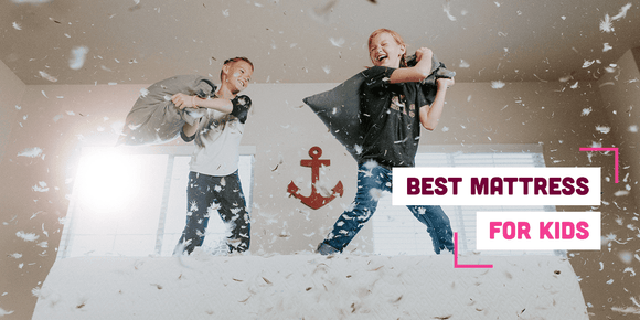 Children pillow fighting on a bed with text