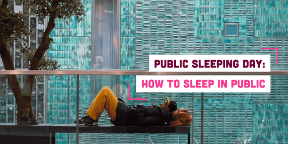 Man sleeping on a public bench with text