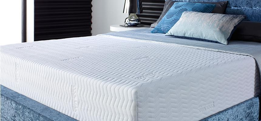 Coolmax mattress cover on bed