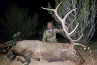 Moster bull elk called in and taken by an Arizona hunter. Elk calling is truly an art, especially during bow hunting season.
