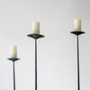 blackened steel sandstone candlesticks the room service